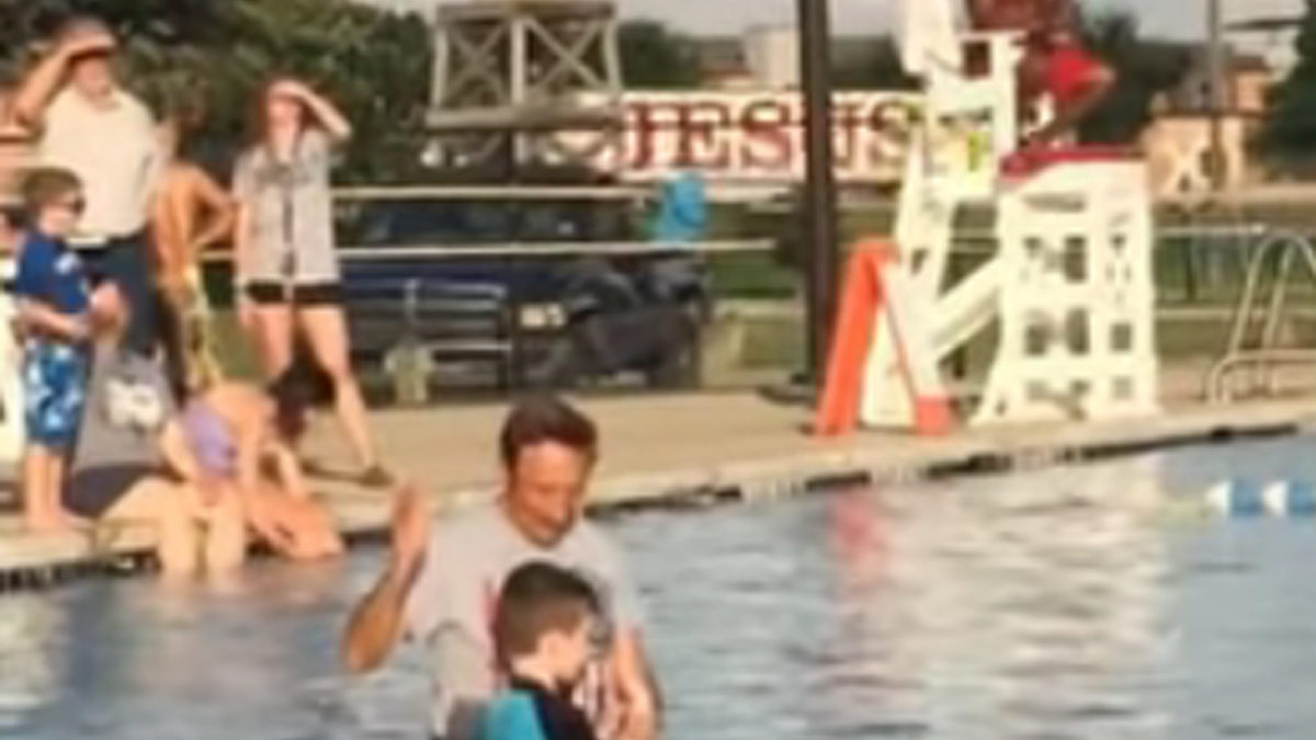Boy Gets Baptized as a Jesus Truck Passes