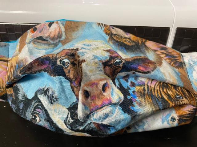 Cow Face Mask - this face mask features different kinds of cattle on it. Great for those who love cows or the cow farmer!