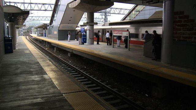 Commuters wait for the train at the Stamford Metro North Station.