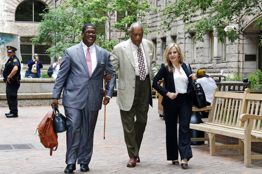 Bill Cosby, center, arrives with one of his attorneys Angela Agrusa, right, for the second day of jury selection in his sexual assault case at the Allegheny County Courthouse, Tuesday, May 23, 2017, in Pittsburgh. The case is set for trial June 5 in suburban Philadelphia. (AP Photo/Gene J. Puskar)