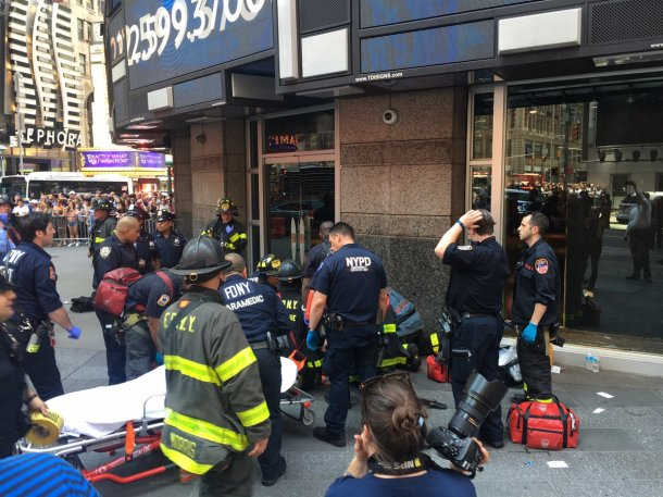 First responders treated victims in Times Square on May 18, 2017, after a reported drunken driver lost control of his vehicle, killing one pedestrian and injuring at least 23 others. (FDNY via Courthouse News Service)