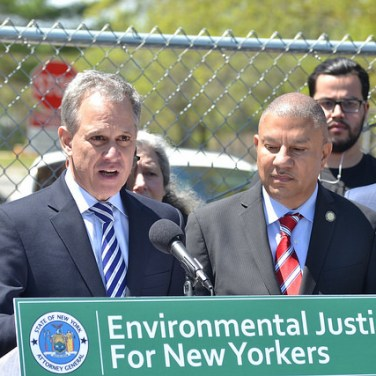 Hosting a May 4, 2017, press conference at the park long shuttered because of asbestos dumping, New York Attorney General Eric Schneiderman announces a lawsuit against accused polluters. (Flickr via Courthouse News)