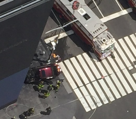 Taken from an office at the Viacom Building, this photograph captures emergency crews at the Times Square crash site where a red Honda drove into pedestrians on May 18, 2017, killing one and injuring 23 others. (Photo by Courthouse News Service)