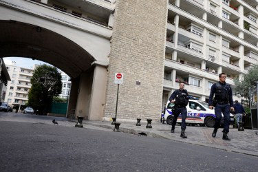 French police officers work near the scene where French soldiers were hit and injured by a vehicle in the western Paris suburb of Levallois-Perret near Paris, France, on Aug. 9, 2017. French police are searching for a driver who slammed his BMW into a group of soldiers, injuring six of them in an apparent ambush before speeding away, officials said. The incident in Levallois, northwest of Paris, is the latest of several attacks targeting security forces in France.(AP Photo/Kamil Zihnioglu)