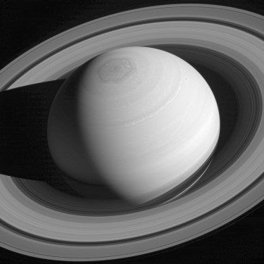 The image of Saturn, encircled by its retinue of rings, was taken with the Cassini spacecraft wide-angle camera on May 4, 2014, using a spectral filter, which preferentially admits wavelengths of near-infrared light centered at 752 nanometers. Although all four giant planets have ring systems, Saturn's is by far the most massive and impressive. Scientists are trying to understand why by studying how the rings have formed and how they have evolved over time. Also seen in this image is Saturn's famous north polar vortex and hexagon. (NASA/JPL-Caltech/Space Science Institute)