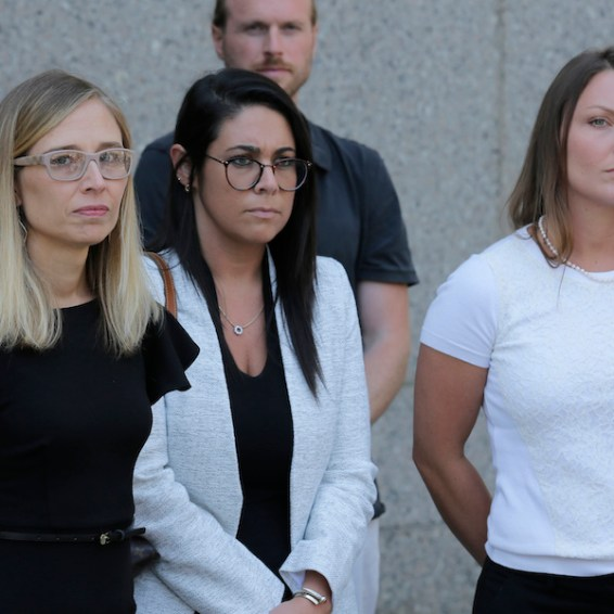 Annie Farmer, left, and Courtney Wild, right, accusers of Jeffrey Epstein, stand outside the courthouse in New York, Monday, July 15, 2019. Financier Jeffrey Epstein will remain behind bars for now as a federal judge mulls whether to grant bail on charges he sexually abused underage girls. (AP Photo/Seth Wenig)