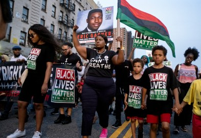 Activists with Black Lives Matter protest in the Harlem neighborhood of New York on July 16, 2019, in the wake of a decision by federal prosecutors who declined to bring civil rights charges against New York City police officer Daniel Pantaleo, in the 2014 chokehold death of Garner. The decision was made by Attorney General William Barr and announced one day before the five-year anniversary of his death, officials said. (AP Photo/Craig Ruttle)