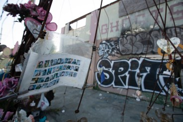 Makeshift memorials erected to the victims of the Ghost Ship warehouse fire, photographed Thursday in Oakland, Calif., as jurors found defendant Max Harris not guilty on 36 counts of involuntary manslaughter. The jury was unable to reach a verdict in the case against co-defendant Derick Almena. (AP Photo/D. Ross Cameron)