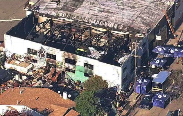 The Ghost Ship Warehouse on Dec. 3, 2016, after a fast-moving fire swept through the building in Oakland, Calif., killing 36 partygoers. (KGO-TV via AP, File)