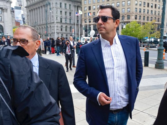 Andrey Kukushkin, right, leaves federal court in New York on Thursday after pleading not guilty to charges that he conspired with associates of Rudy Giuliani to make illegal campaign contributions. (AP Photo/Craig Ruttle)