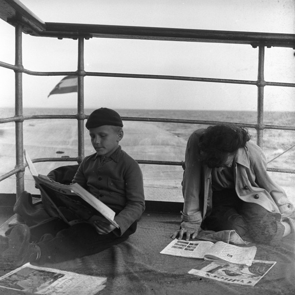 Janine Girdner and unknown boy reading on lookout in unknown location circa 1950, from Walt Girdner's Europe collection.