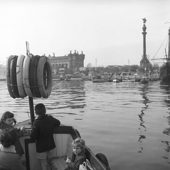 Aboard a chartered boat in Barcelona's marina. The monument to Christopher Columbus rises high above the harbor in the background. From Walt Girdner's Europe collection.