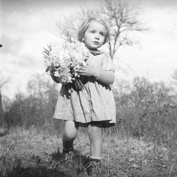 Girl with fresh-picked flowers in the French countryside. From Walt Girdner's Paris collection.