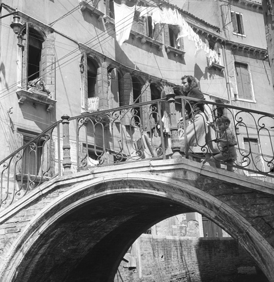 Crossing a Venetian canal with son in tow. From Walt Girdner's Europe collection.