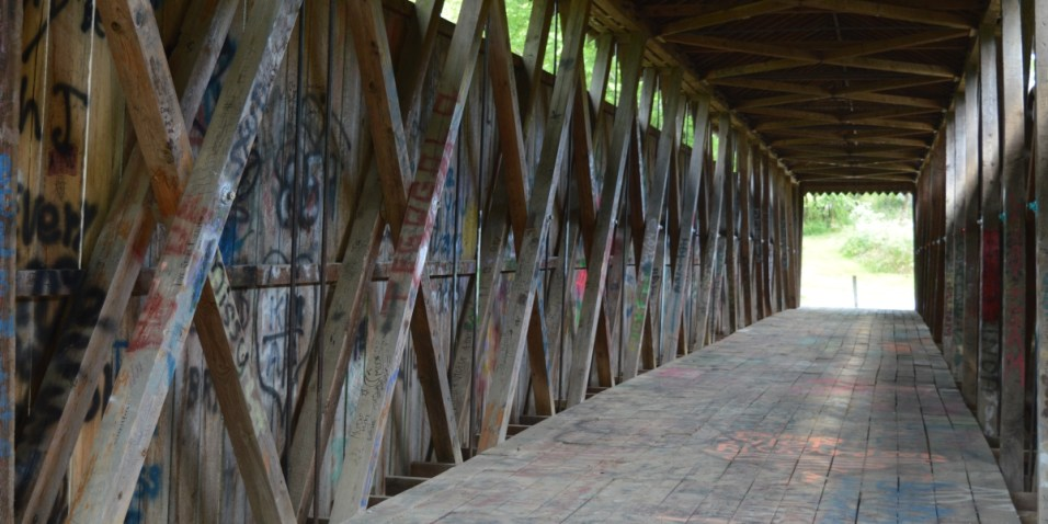 Switzer covered bridge covered in graffiti