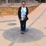 Connie standing on all four states