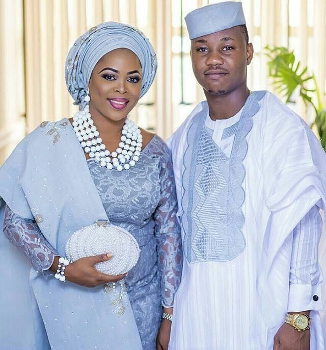 blue aso oke Yoruba traditional wedding attire image