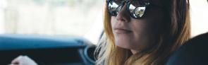 teenage girl looking back in car
