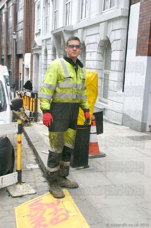 Power Utility Workman Wearing Hi Vis YellowBlue Boilersuit Overall