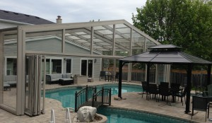 Pool Enclosure retracts over House