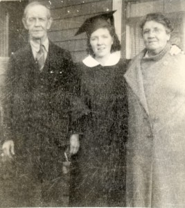 A 1938 photograph of Charles A. Manning, Addie (Ryan) Manning, and in between them, their daughter, Mary in graduation garb.