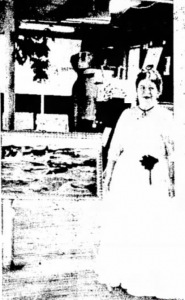 Mrs. Rose Labrie, Portsmouth artist, stands with one of her paintings at her week-long art exhibit at the Sheafe Warehouse in Portsmouth NH, August 1973