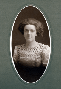 Gertrude May Batchelder, daughter of Fred L. & Annie (Lampron) Batchelder of Nashua NH. Photograph probably taken in 1910.
