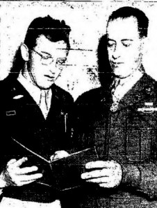 """Sgt. Christos H. Karaberis, right, holder of the Congressional Medal of Honor and newest member of the Army and Air Force recruiting station at 10th and Jackson Streets, shows his CMH citation to Capt. A.L. Caldwell, recruiting offer. Karaberis received the Nation's highest military decoration from President Truman for wiping out five German machien guns nests single-handed. """"I only wish finding a place to live was half as easy,"""" Karaberis said.--Tribune photo"""