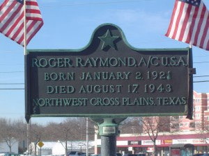 Photograph of J. Roger Raymond recognition plaque, located in Manchester NH at the southeast corner of Queen City Ave and Second Street. Copyright of Martin Miccio for the City of Manchester, and used here with permission.