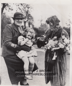 May 1941, Mrs. Winant (far right) visited the Regent Lodge Receiving Nursery, following her husband's presentation of $280,000 to the W.V.S from the American Red Cross. On left holding the child is Lady Reading, Chairman of the Women's Voluntary Services in Britain. The child is not named.