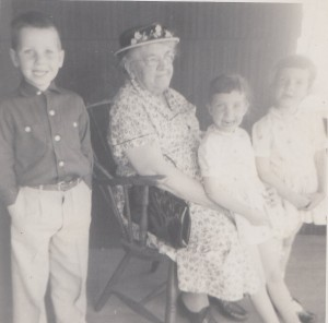 Addie (Ryan) Manning, seated with some of her grand children. L to R, Peter, Janice and Kathi Webster.