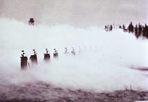 Photograph showing a cloud of poisonous gas produced by mobile cylinders during WWI, National Library of Medicine.