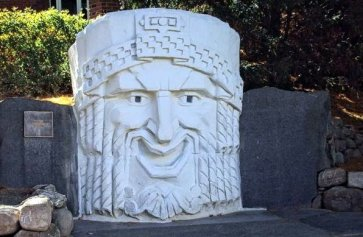 """""""Muse of Comedy,"""" the art deco head originally from the State Theatre in Manchester NH, now sitting on the campus of St. Anselm College."""