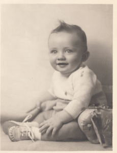 Unknown baby found with photographs in this same album. Who is he or she?