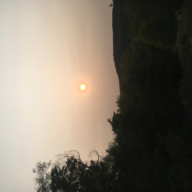 The evening Sun through the haze of smoke and ash in the upper atmosphere from the wildfires in western North America
