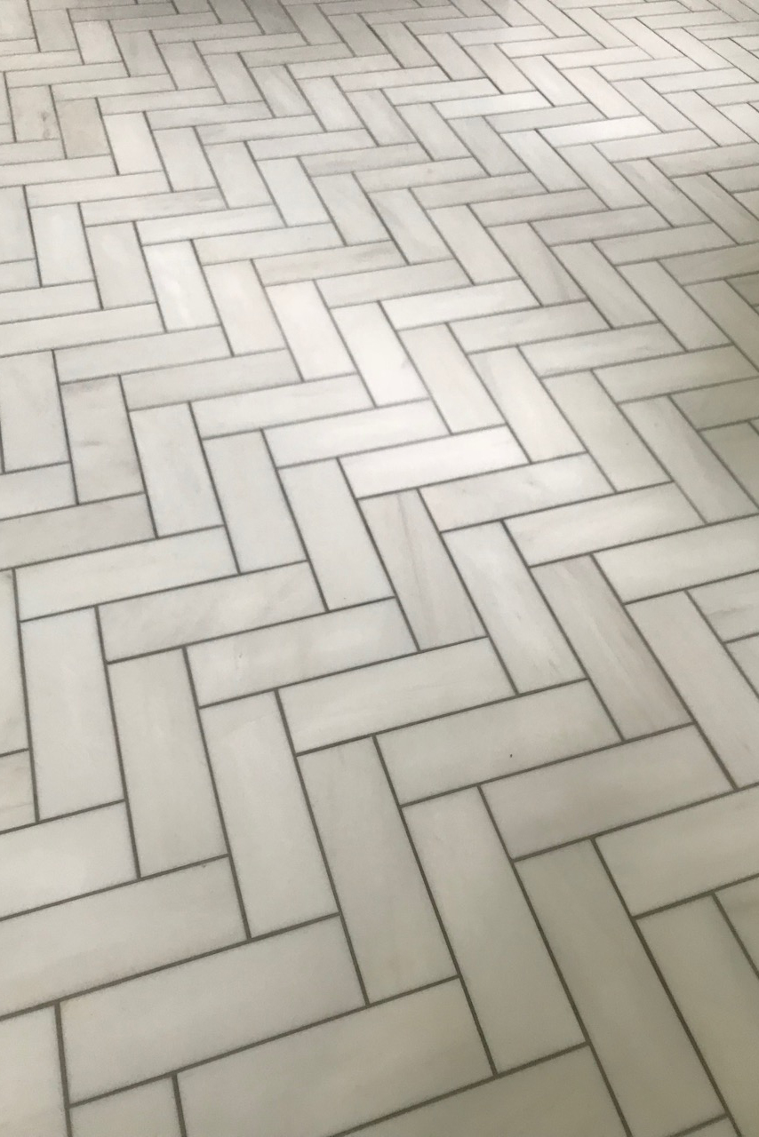 Artistic Tile bianco dolomiti herringbone tile