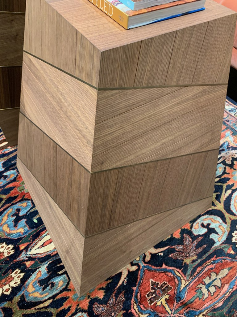 quarter-sawn wood grain with brass inlay at Highpoint Market