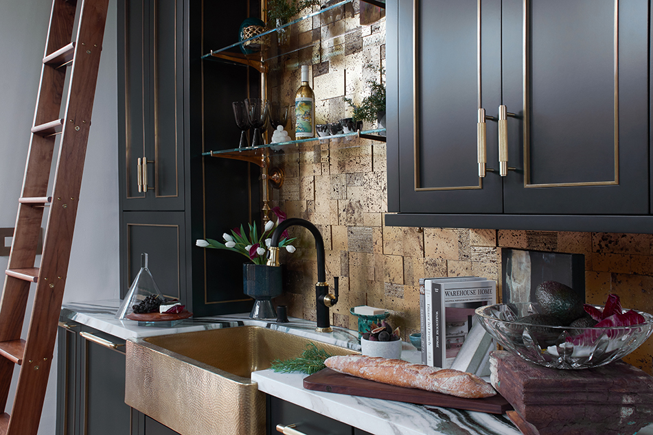 Luxury Pasadena loft kitchen with black cabinetry and brass sink and backsplash