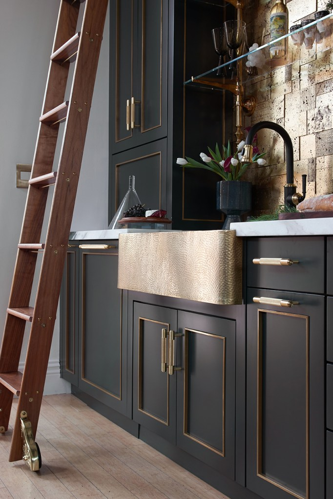 black and brass kitchen with rolling library ladder