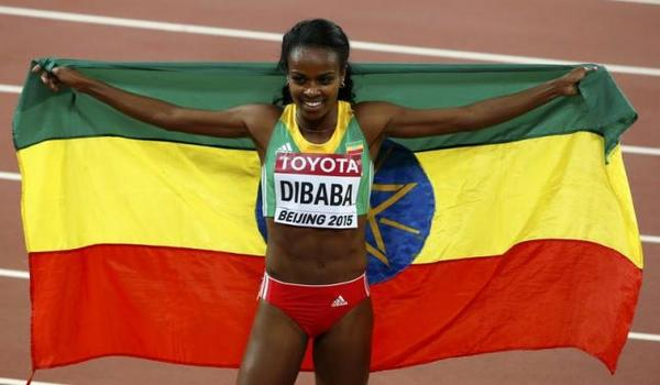 Genzebe Dibaba of Ethiopia celebrates winning the women's 1500 metres final during the 15th IAAF World Championships with her national flag at the National Stadium in Beijing, China August 25, 2015. REUTERS/David Gray
