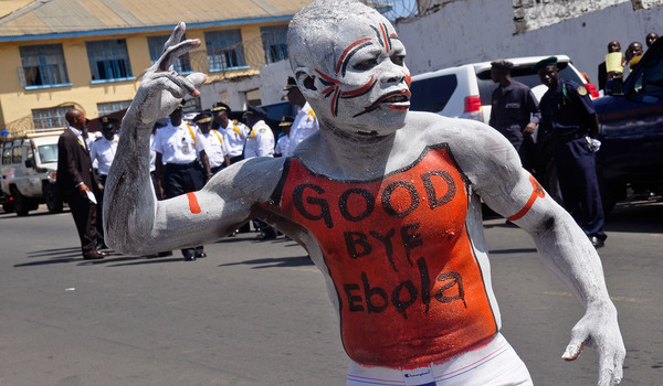 A man takes part in the celebrations, to mark Liberia being an Ebola free nation in Monrovia, Liberia, Monday, May 11, 2015. Liberians are gathering in the streets of the capital to celebrate the end of the Ebola epidemic in this West African country. Monday's festivities come after the World Health Organization declared over the weekend that Liberia was finally Ebola-free. (AP Photo/ Abbas Dulleh)