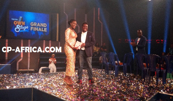The fourth placed contestant in the contest receiving her TECNO Phantom 5.
