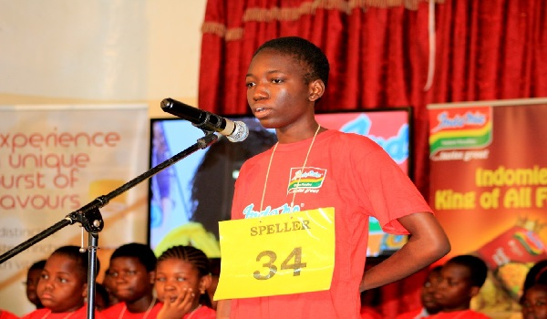 Efua, the eventual winner of the Ghana National SPelling Bee competition on stage taking his turn