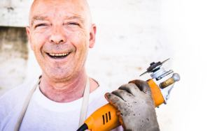 A man holding an electric saw may need First-Aid one day.