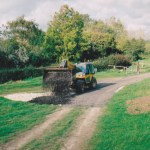 Tractor making track way with chalk and road planings