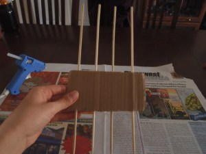 1.Take a chunk of cardboard (the nice thick stuff with the holes in the sides rather than the thin stuff from food boxes) and stick four skewers through the sides. The spacing between the skewers will determine how big your bow is. (Big space = big bow, little space = little bow). Play around with spacing to determine your preference. It's easy to switch it up.