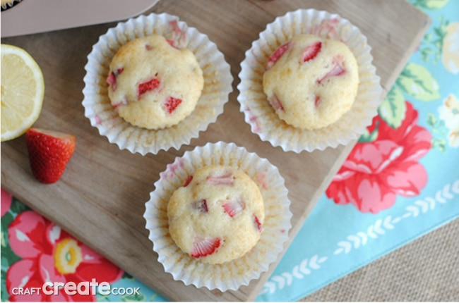 Strawberry Lemon Muffins combine fresh strawberries and lemon zest for a delicious grab and go breakfast or a quick snack!