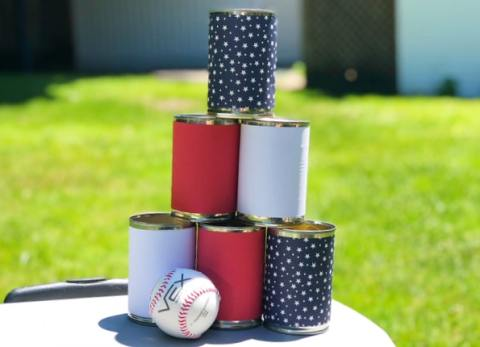 Our Easy Tin Can Ball Toss Game is the perfect backyard game and it only takes a few minutes to make.