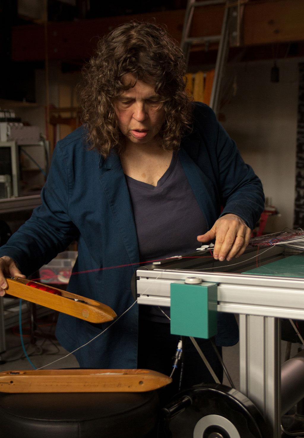 Lia Cook at the loom. Mark Markley photograph