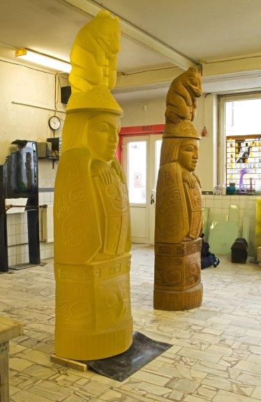 Family Story Totem by Preston Singletary and carved cedar log totem by David Svenson